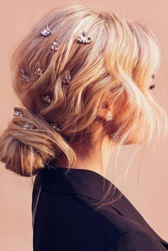 wedding hair trends messy textured low blonde bun crystals pins nastya_kopach
