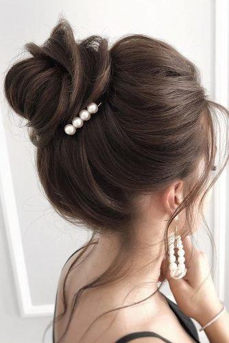 wedding hair trends elegant textured high bun on brown hair with pearls juliafratichelli.bridalstylist
