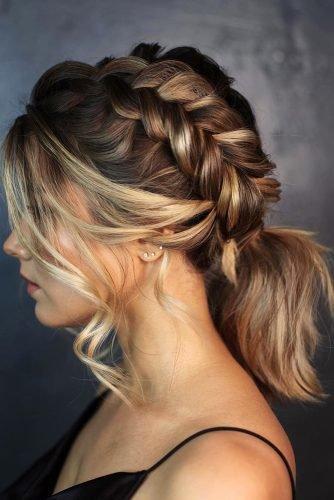 wedding hair trends medium hair ponytail with side braid and loose curls kiramaslik