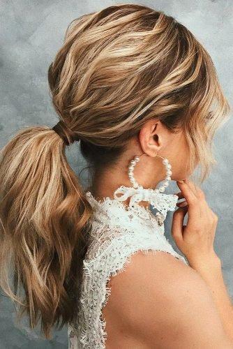 wedding hair trends textured blonde wavy ponytail belaya_lyudmila
