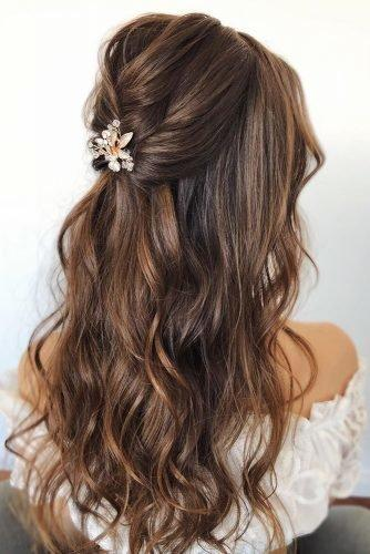 wedding hair trends relaxed loose waves and curls on long brown hairdown elegant hairpin caraclyne.bridal