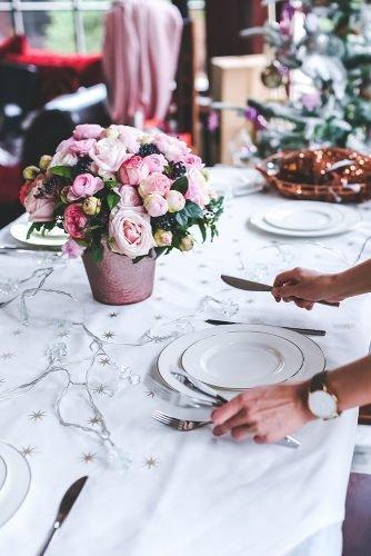 average cost of wedding venues woman preparing wedding table