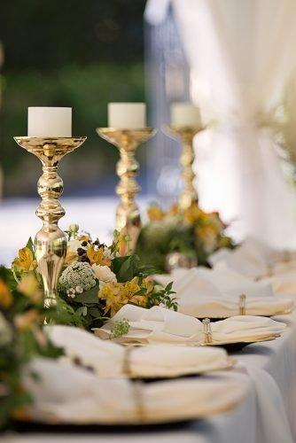 average cost of wedding venues candlesticks on table with wedding set up