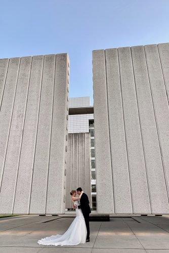 wedding venue ideas newlyweds hugging near art gallery