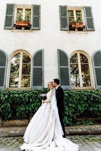 wedding venue ideas photo of bride and groom standing near hotel