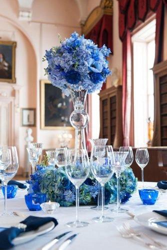 classic blue wedding tall glass vace with flowers photography by ally byrom