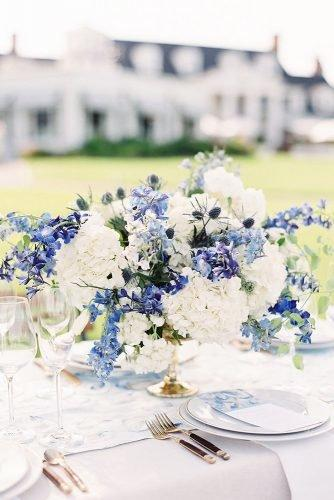 classic blue wedding simple flower centerpiece in gold vase ashley relvas photography