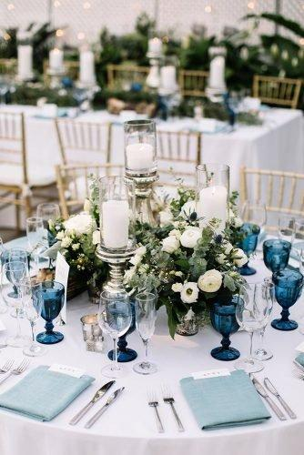 classic blue wedding round table with bohemian glasses and white flowers brittneyraine