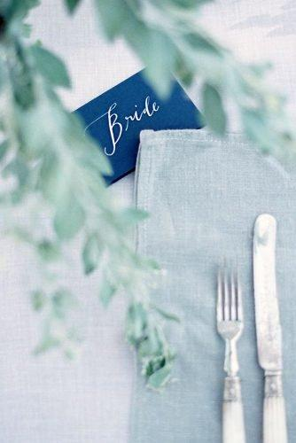 classic blue wedding light blue tablecloth greenery and place setting sign theresa furey photography