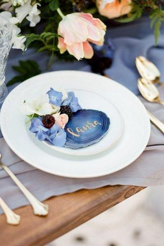 classic blue wedding table setting with flowers and berries kristen joy photography