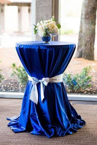 classic blue wedding lounge table with white flowers in vase cory ryan photography
