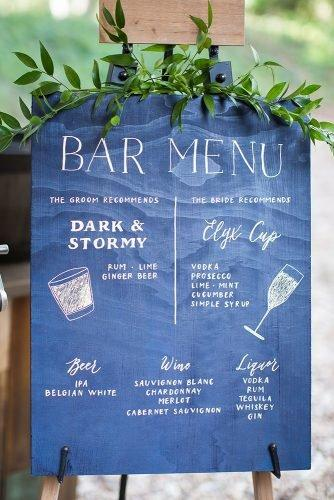 classic blue wedding blue board with greenery and bar menu kreate photography