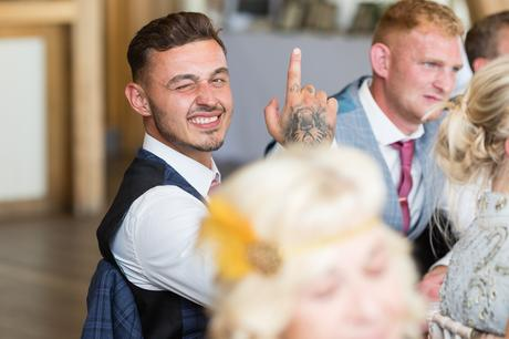 Guest making a face for the camera at fun York wedding.