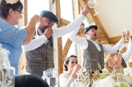Raising glasses for a toast at Sandburn Hall Wedding.