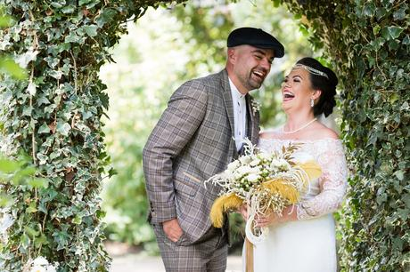 Peaky Blinders styled couple laughing during couples portraits at York Wedding.