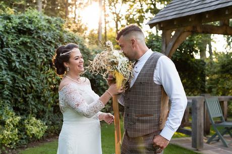 Groom sniffs brides flowers having fun at York wedding.