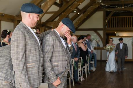 Groom cries as he sees his bride walk up the aisle at Sandburn Hall wedding.