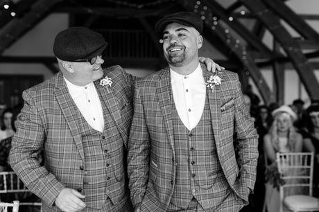 Groom's dad put his arm around son at beginning of wedding ceremony at Sandburn Hall.