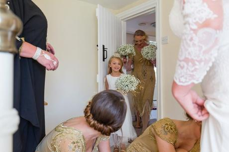 Bride's daughter sees mother for first time with big smile at Yorkshire wedding.