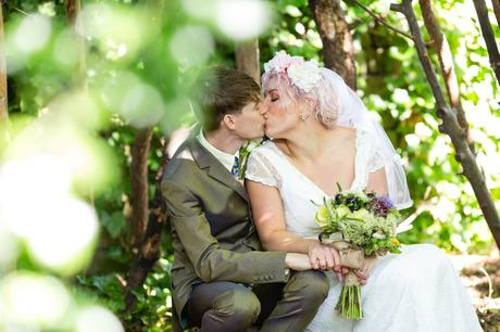 Bride with pink hair has a woodland kiss at East Riddlesden Hall wedding