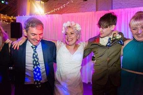 Bride in flower crown dancing.