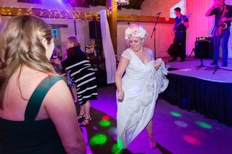 Bride dancing and having fun at East Riddlesden Hall wedding.
