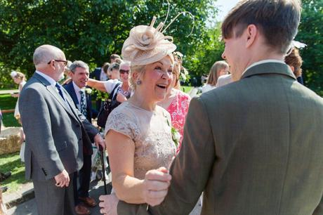 Bride's mother smiles at groom during post ceremony mingle at Yorkshire Wedding