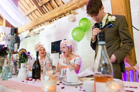 Bride makes shocked face during a funny wedding speech at East Riddlesden Hall