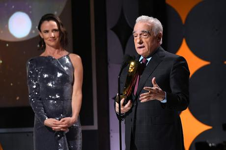 Martin Scorsese (R) accepts Best Director for 'The Irishman' from Juliette Lewis onstage during AARP The Magazine's 19th Annual Movies For Grownups Awards at Beverly Wilshire, A Four Seasons Hotel on January 11, 2020 in Beverly Hills, California.