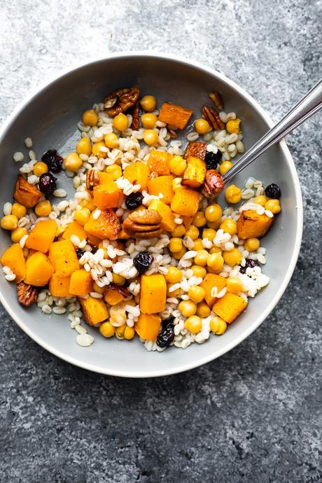 overhead view of Chickpea, Barley and Butternut Squash Jar Salads shaken out into a bowl
