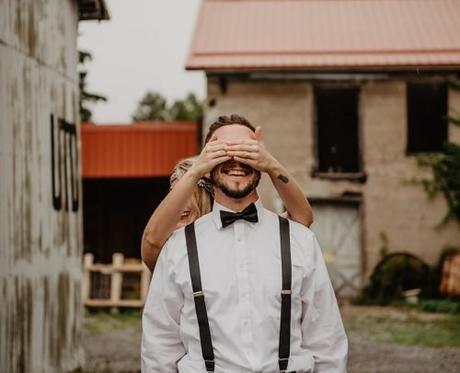 groom wedding planning bride covering mans eyes