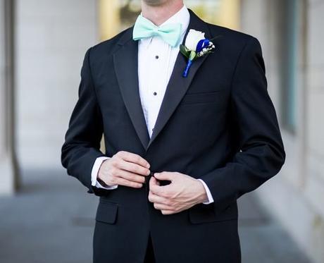 groom wedding planning man wearing black and teal tuxedo
