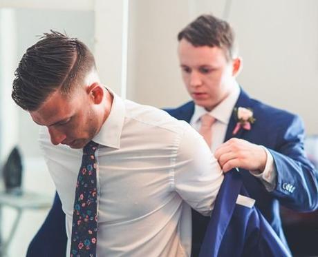 groom wedding planning man wearing his formal coat