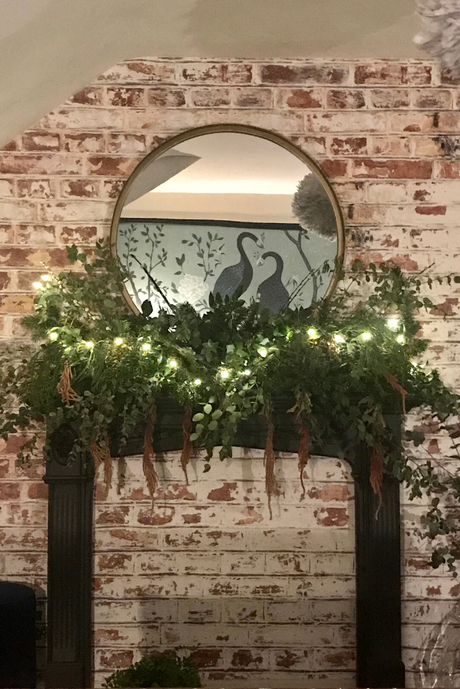 mirror on an exposed brick wall