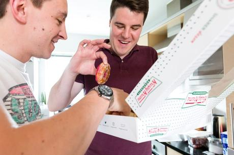 Groomsmen eat Krispy Kreme doughnuts at Asylum wedding.