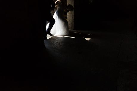 Painting with light dark and light entrance of bride walking into the Asylum wedding venue.