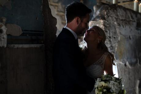 Dark, keylight couple's portrait at The Asylum wedding venue.