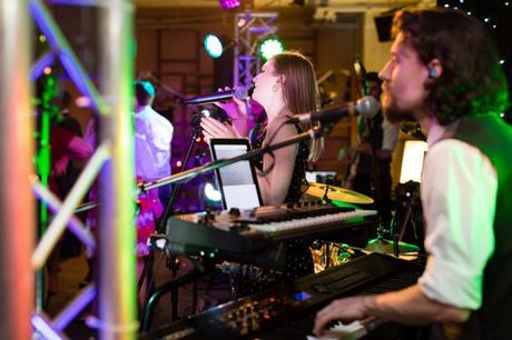 Band sings during London wedding.