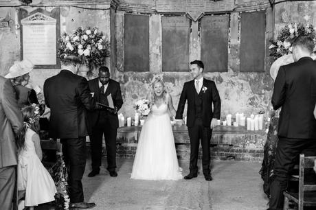 Bride laughs as she walks up the aisle.