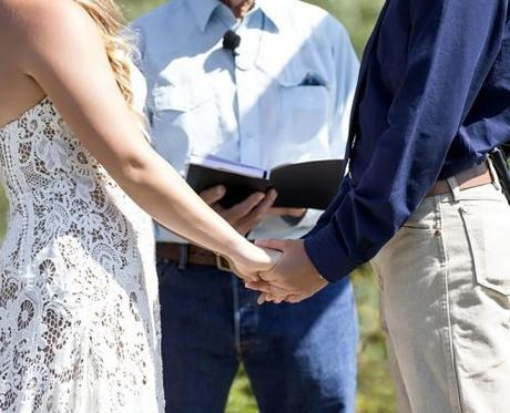 officiant prices for wedding ceremony couple holding hands