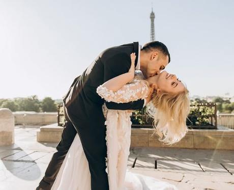 unique wedding songs paris groom kissing bride