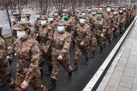 Members of a military medical team were deployed to Wuhan on Sunday.