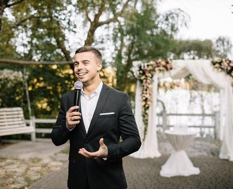 wedding welcoming speeches man with microphone giving a speech