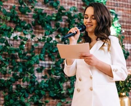 wedding welcoming speeches woman with microphone speak