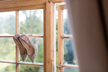 Glittery shoes in window at Achnagairn Estate wedding