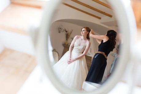 Reflection of redheaded bride in mirror at wedding in Inverness