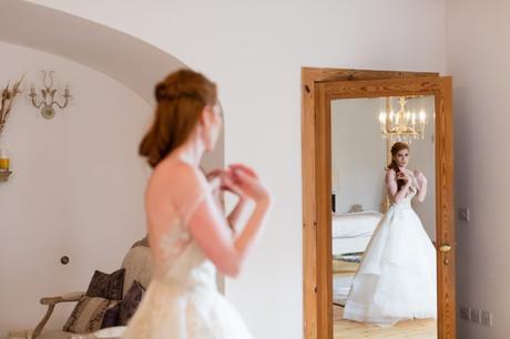 Reflection of redheaded bride in mirror at Achnagairn Estate wedding