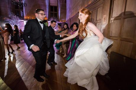 Dancing at wedding with redheaded bride.