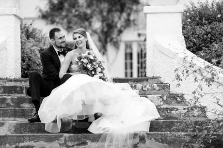 Couple laughing together on the steps in Wedding Photography at Achnagairn Estate