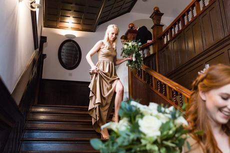 Bridemaids walk down wooden stairs at Achnagairn Estate